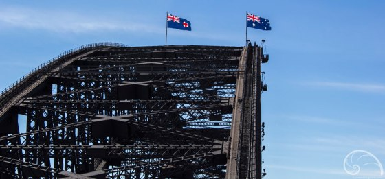 Flags of Australia and the UK waving proudly at the peak.